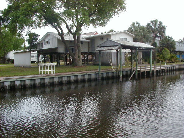 MLS# 771783 Cute cottage on canal w/dock and boathouse!